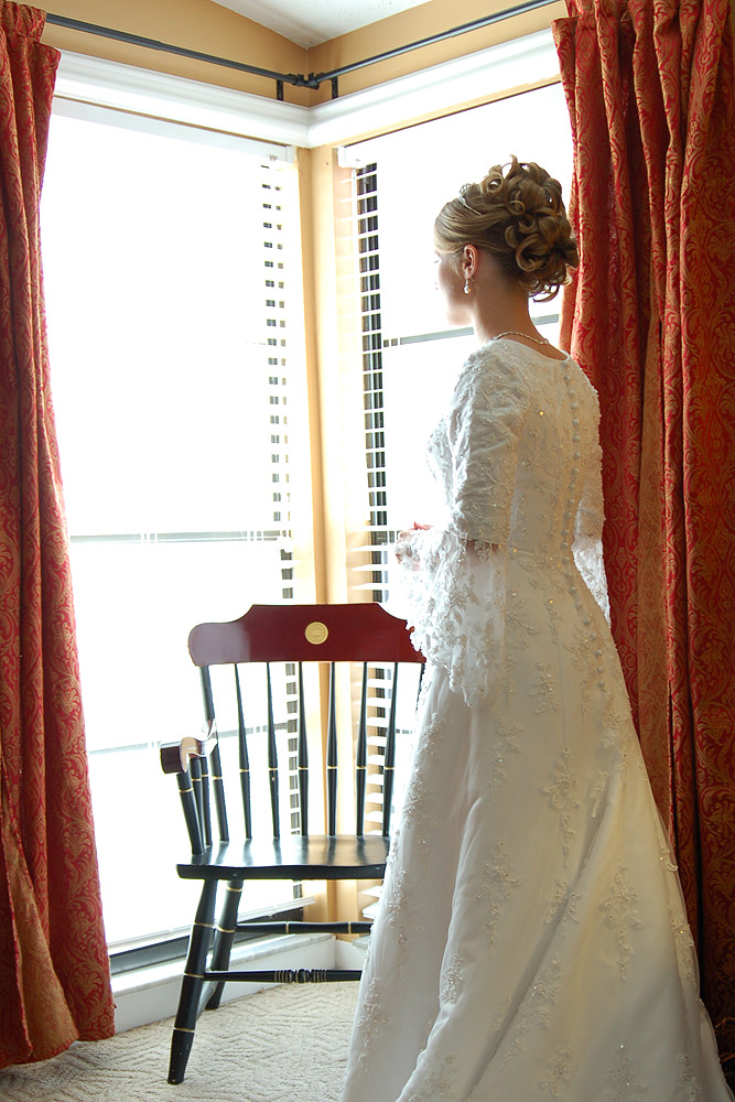 Bride Looking Outside Window