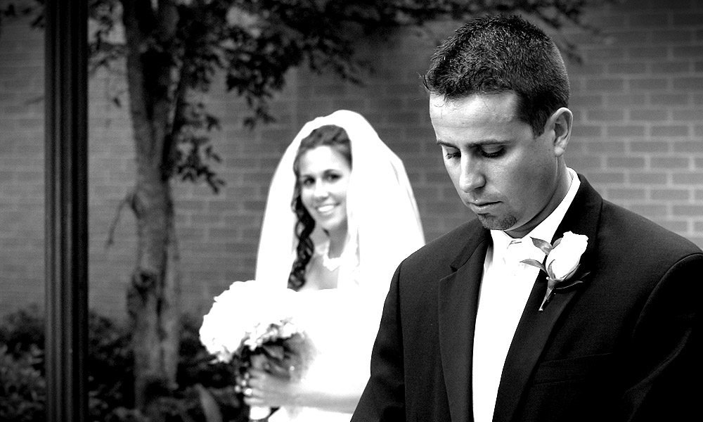 Bride Looking at Pensive Groom