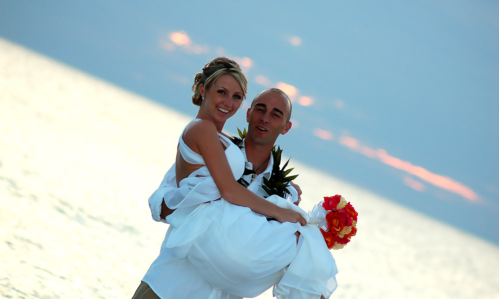 Holding Bride on Beach